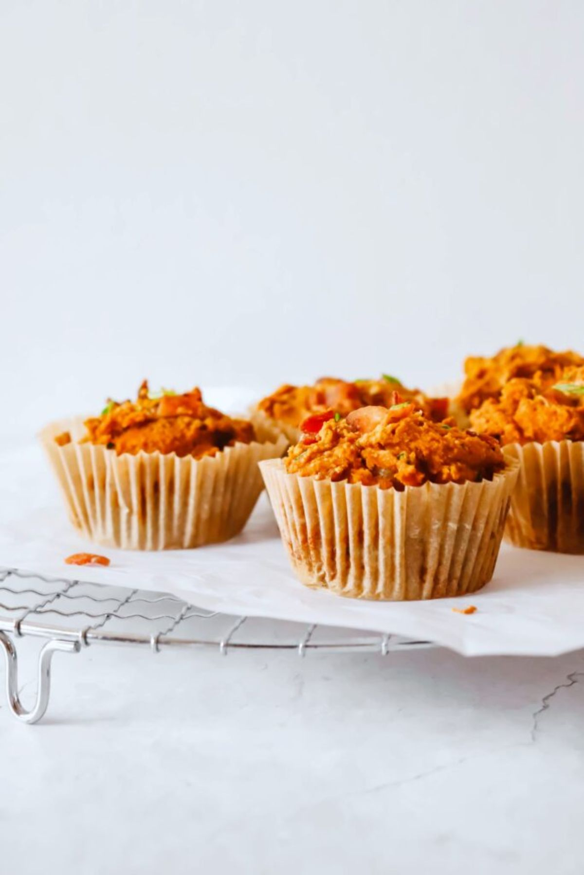 a cooling tray laden with sweet potato bacon and chive muffins