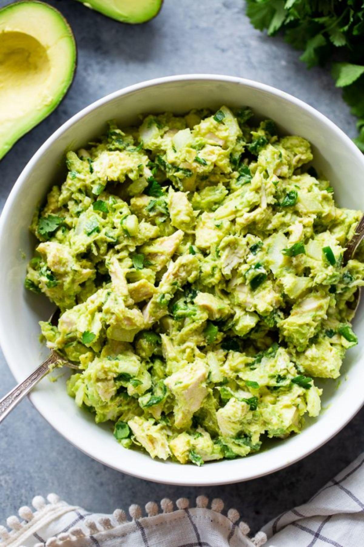 a bowl of guacamole chicken salad