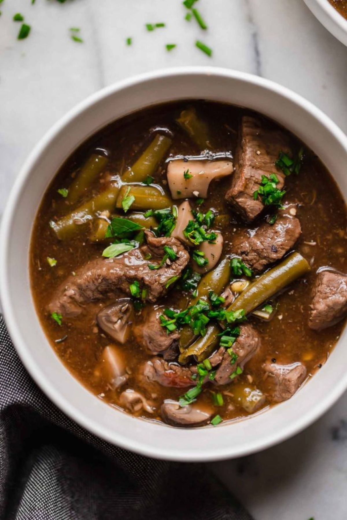 beef stew in a round white bowl
