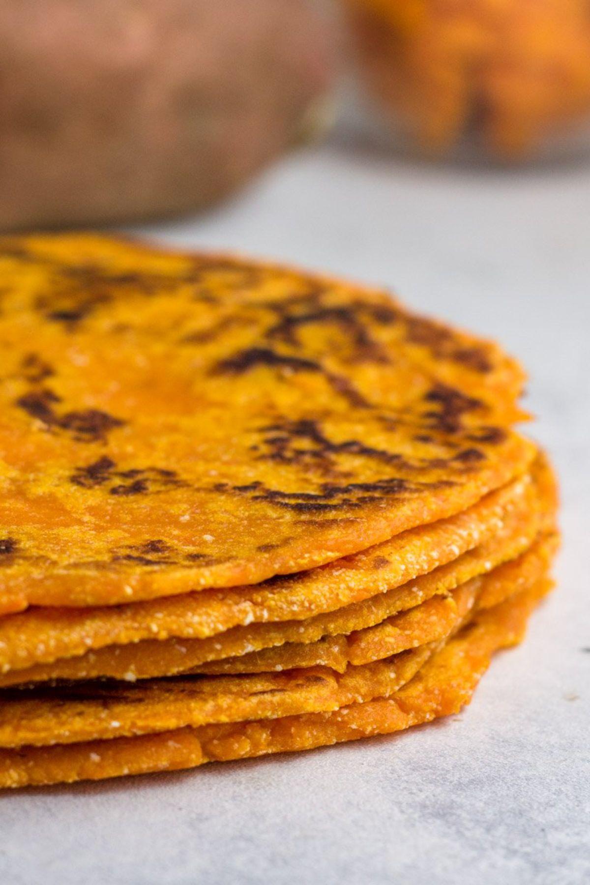 a pile of sweet potato tortillas