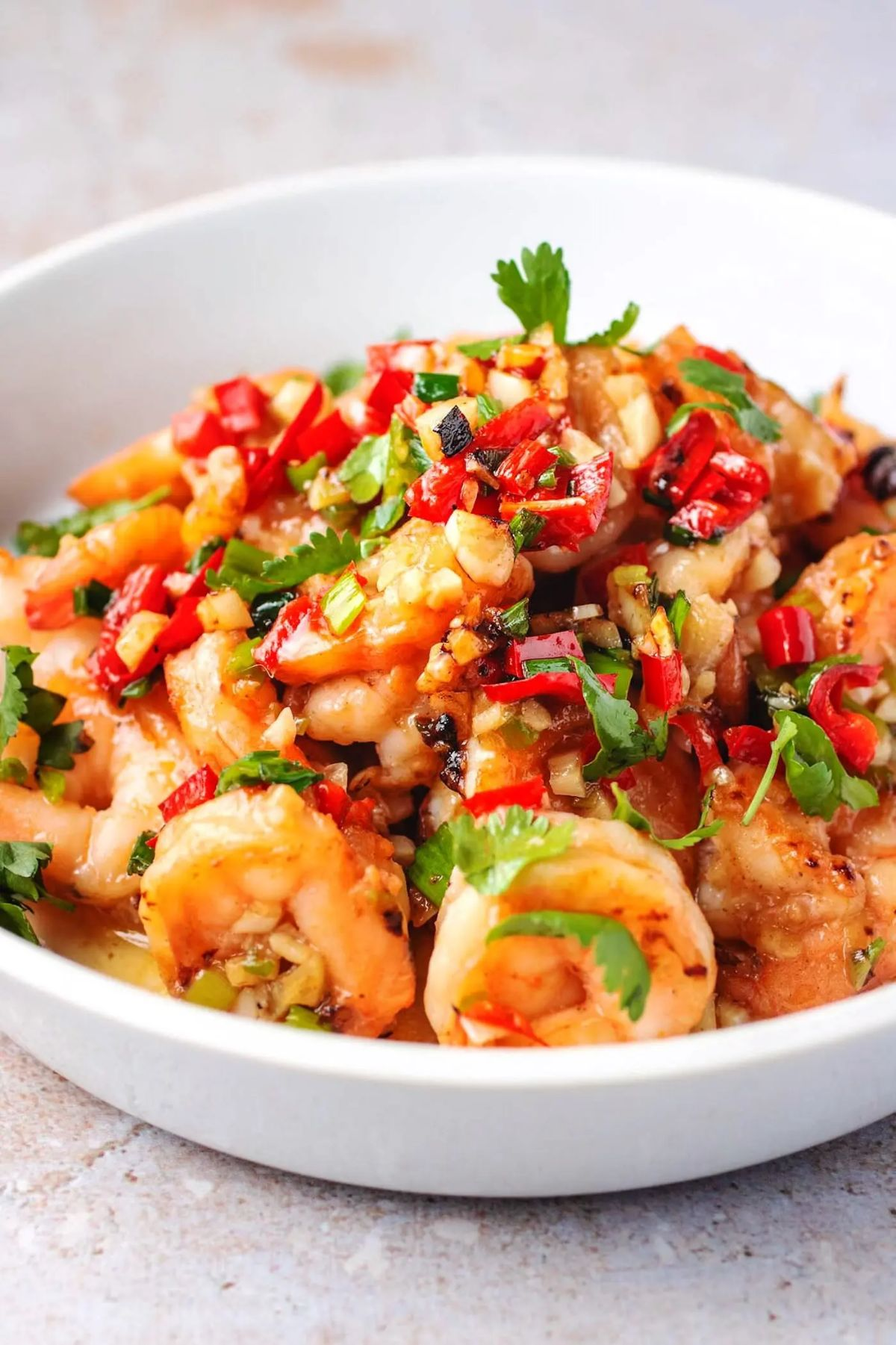 a bowl of shrimp and chopped vegetables