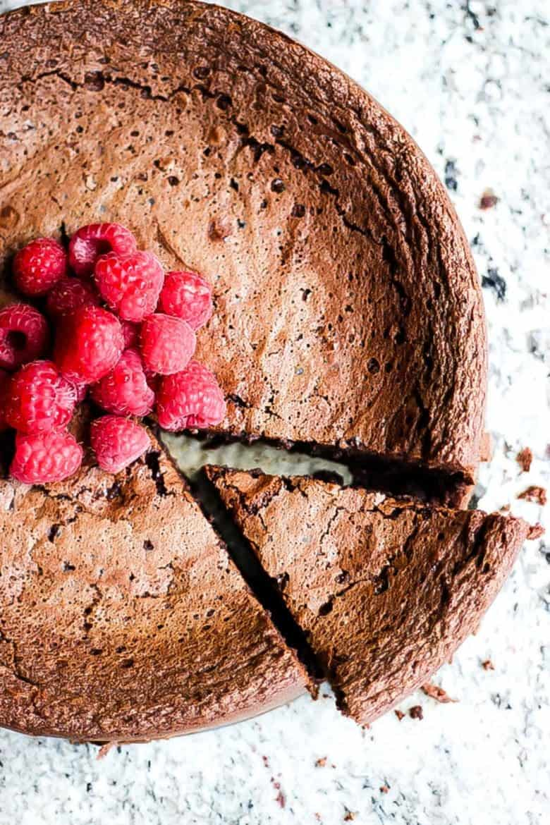 This flourless Chocolate Torte is gluten free and very rich and fudgey. Served with a quick raspberry puree and vanilla ice cream you just can't go wrong.