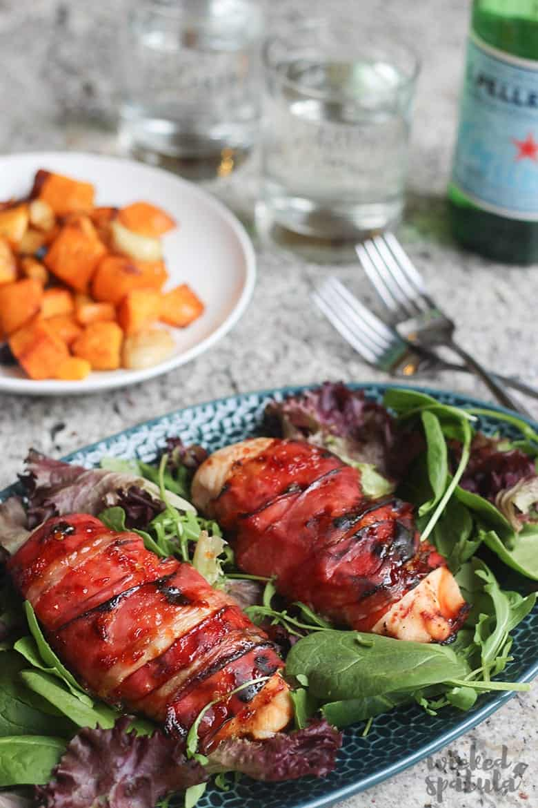 Prosciutto Wrapped Chicken Breast Recipe - Dinner Plate with chicken on bed or spinach