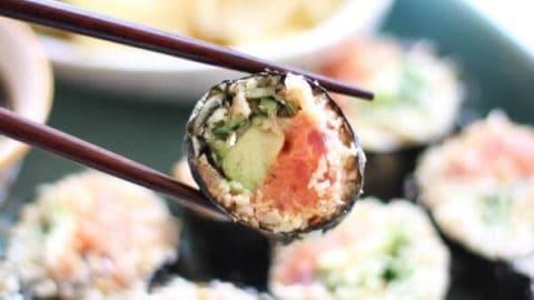 Paleo Cauliflower Rice Sushi Rolls Recipe (Spicy Tuna) - Sushi roll with chop sticks