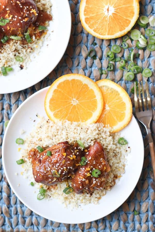 Easy Paleo Crock Pot Slow Cooker Orange Chicken - 2 plates with orange chicken