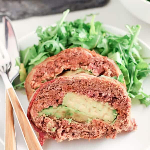 Side Shot of Mexican Style Paleo Meatloaf Stuffed With Avocado and Green Salad