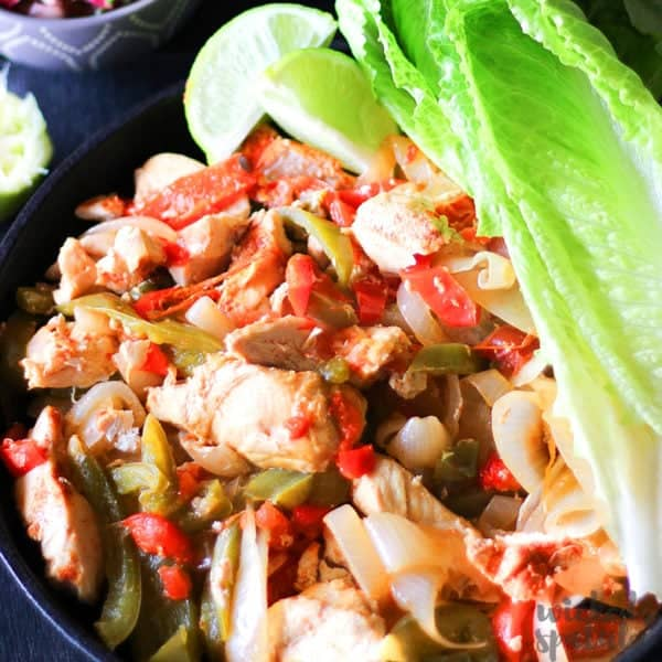 healthy chicken fajitas in a cast iron skillet