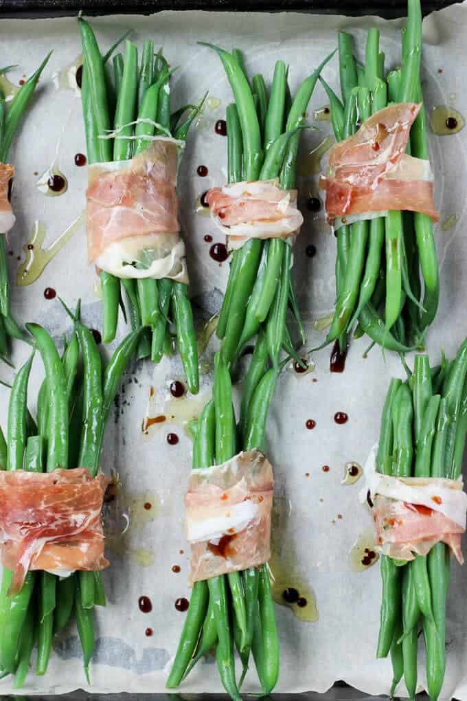 Crispy Prosciutto Wrapped Balsamic Green Beans on a baking tray