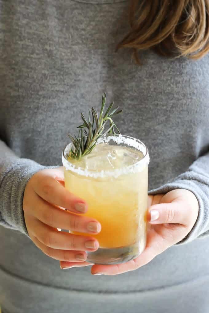 Rosemary Ginger Margarita on hands