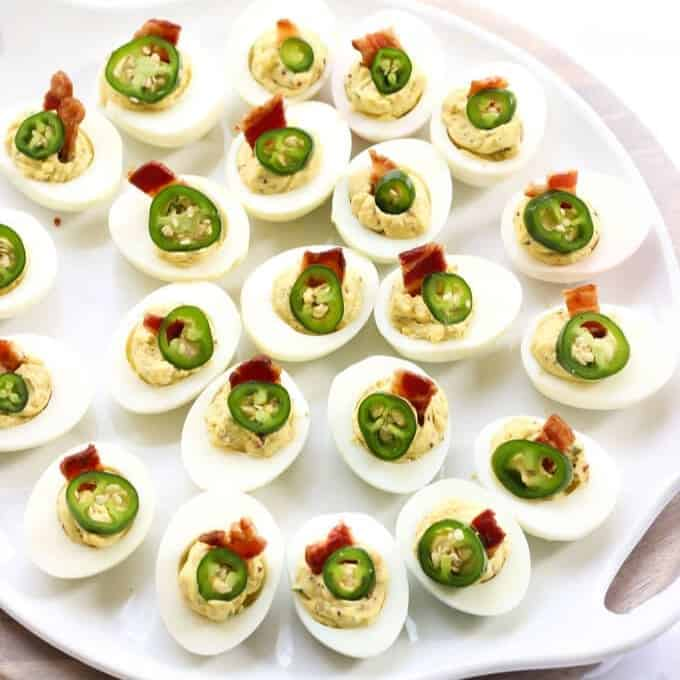 Bacon Jalapeno Deviled Eggs Recipe - Plate full of deviled eggs
