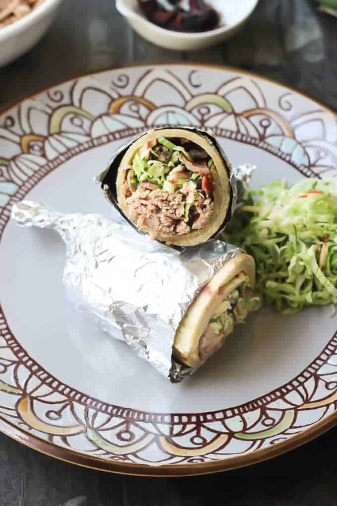 Paleo Pulled Pork Burritos with Brussels Sprout Apple Slaw, Candied Jalapeños, and White BBQ Sauce