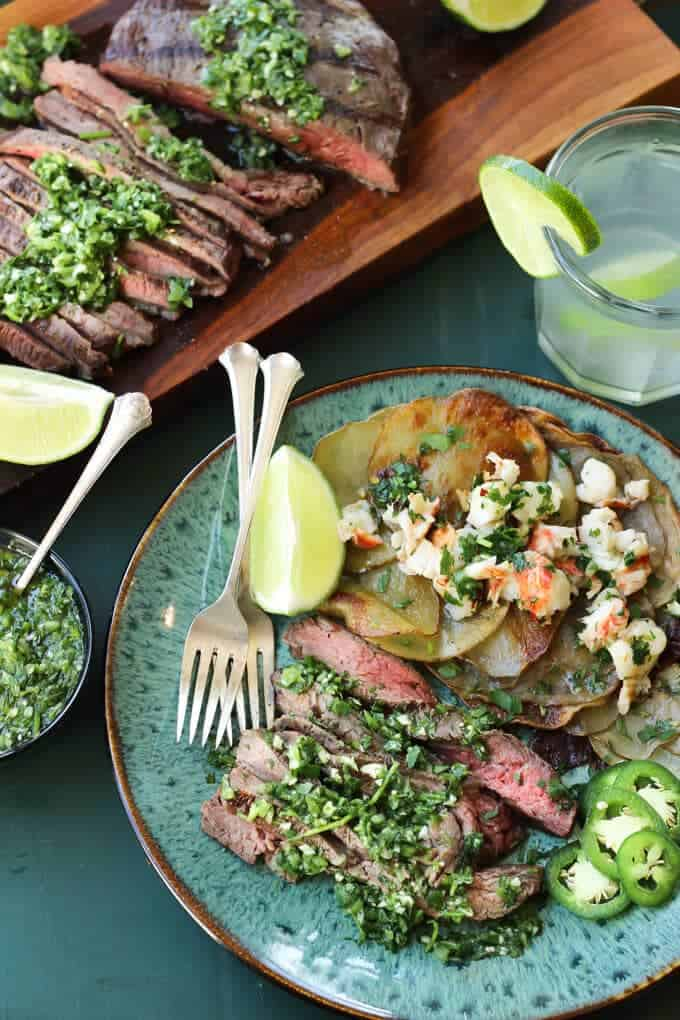 Tomatillo Chimichurri Flank Steak with Spiked Herb Butter Lobster Potatoes