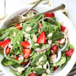 Easy Almond Strawberry Spinach Salad Recipe With Poppy Seed Dressing - Bowl with salad and forks