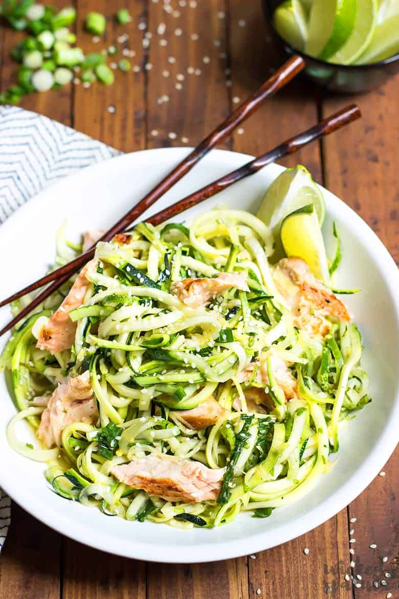 zucchini noodle salad recipe with salmon - in a bowl with chopsticks