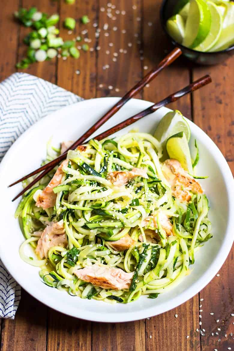 bowl filled with zucchini noodles and salmon