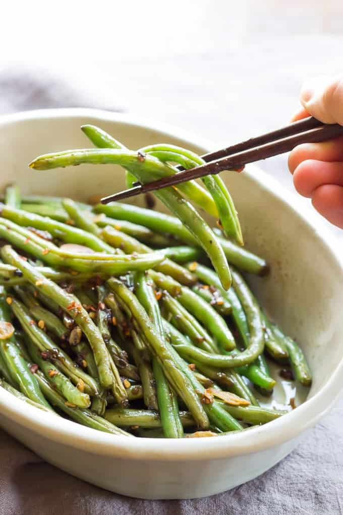 Overhead Shot Of Spicy Asian Green Beans In White Bowl With Chopsticks