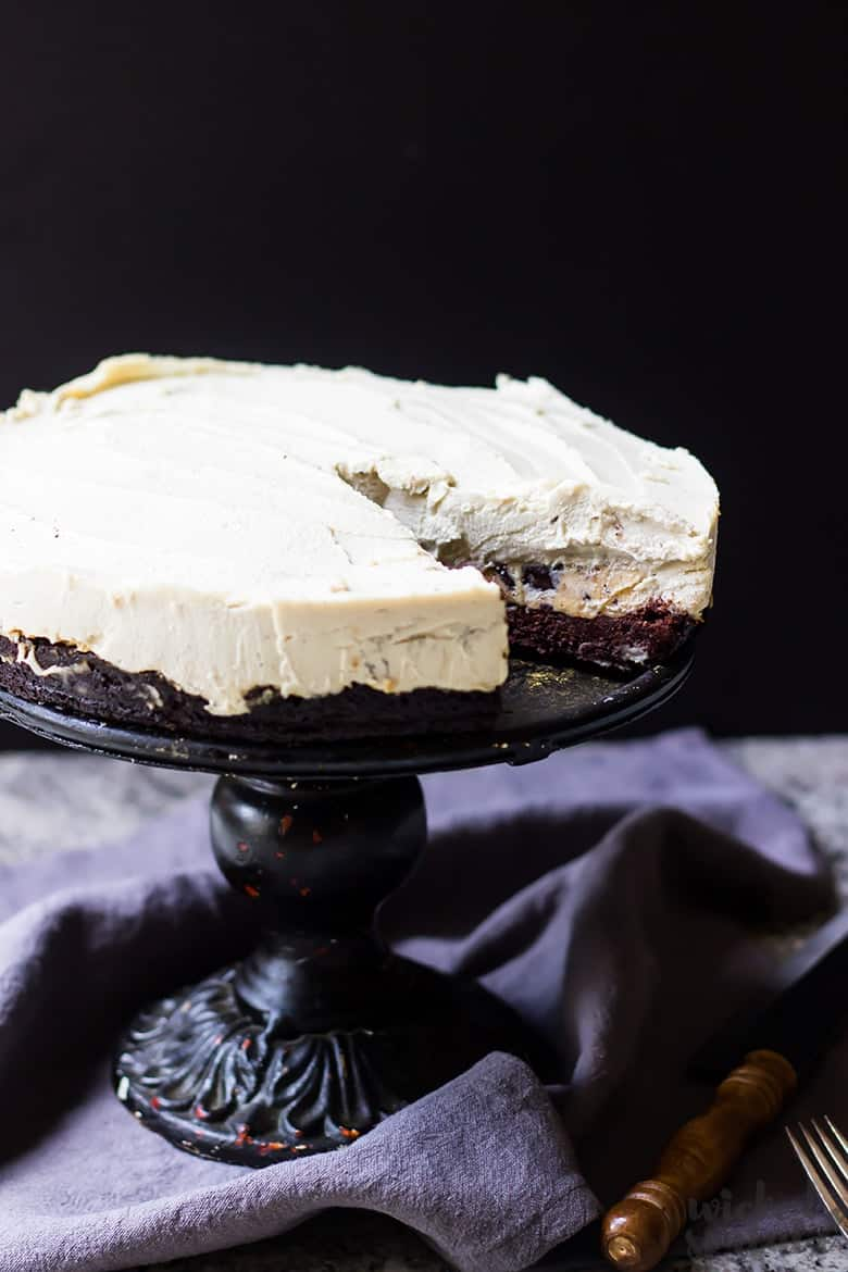 whole paleo cheesecake on a cake stand