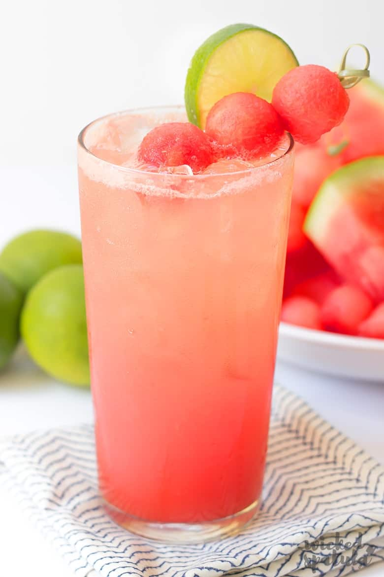 Watermelon lime coconut refresher with lime and watermelon garnish