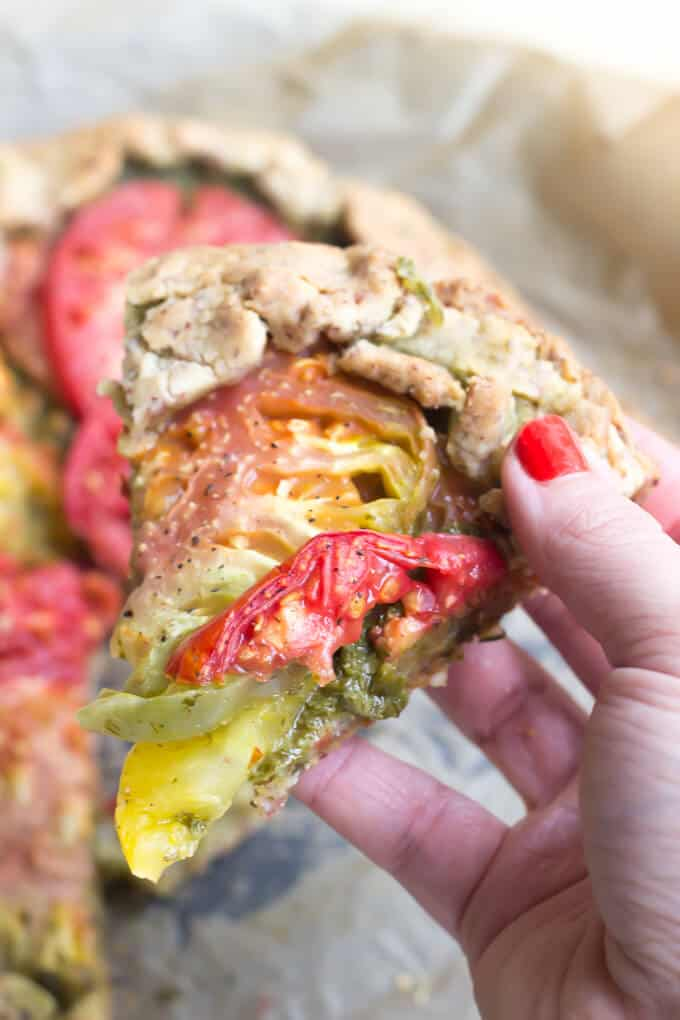 Rustic Paleo Tomato Galette with Arugula Basil Pesto on hand