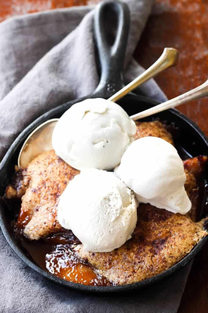 Mini Paleo Peach Cobbler! This easy Paleo dessert is perfect for two! The pastry is light and fluffy just like normal cobbler   wickedspatula.com