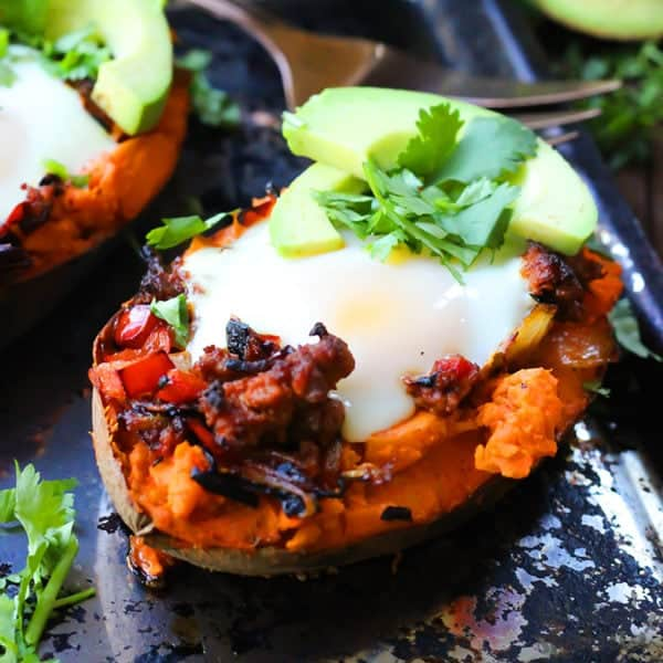 healthy stuffed sweet potatoes topped with avocado ready to eat