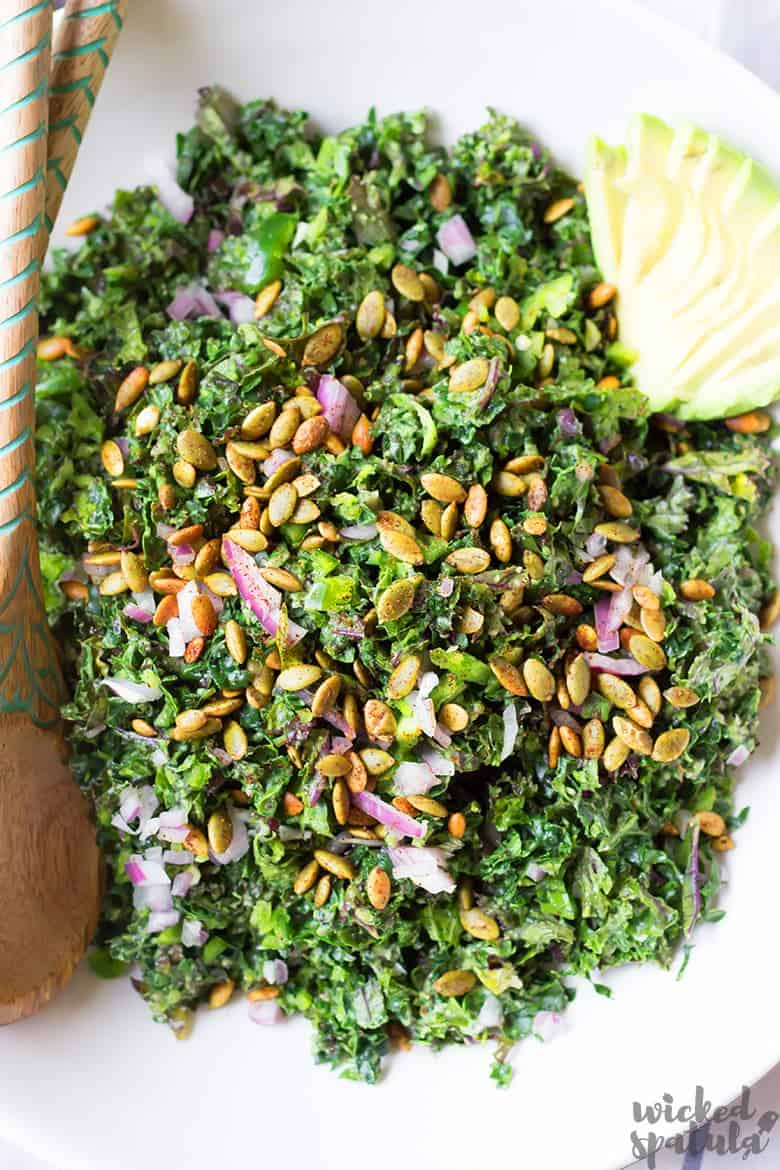Vegan Kale Caesar Salad Recipe - salad with avocado and spoon