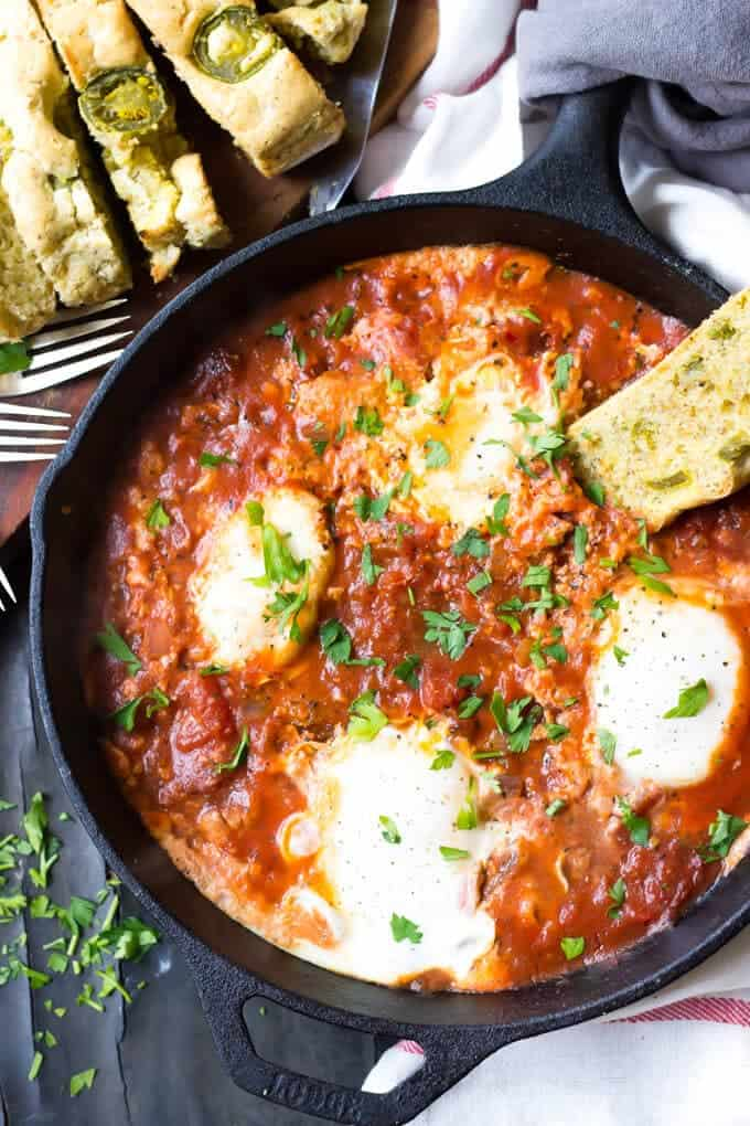 Easy Paleo Eggs In Hell Recipe - Eggs In Hell in Pan With Bread on plate.