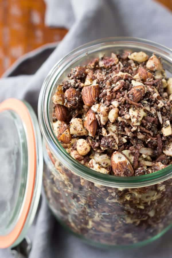 Paleo Chocolate Fudge Coconut Granola - this easy 30 minute granola is loaded with chocolate goodness and is low in sugar! Plus it's also vegan!
