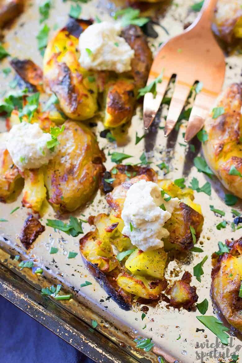 garlic smashed potatoes on a pan