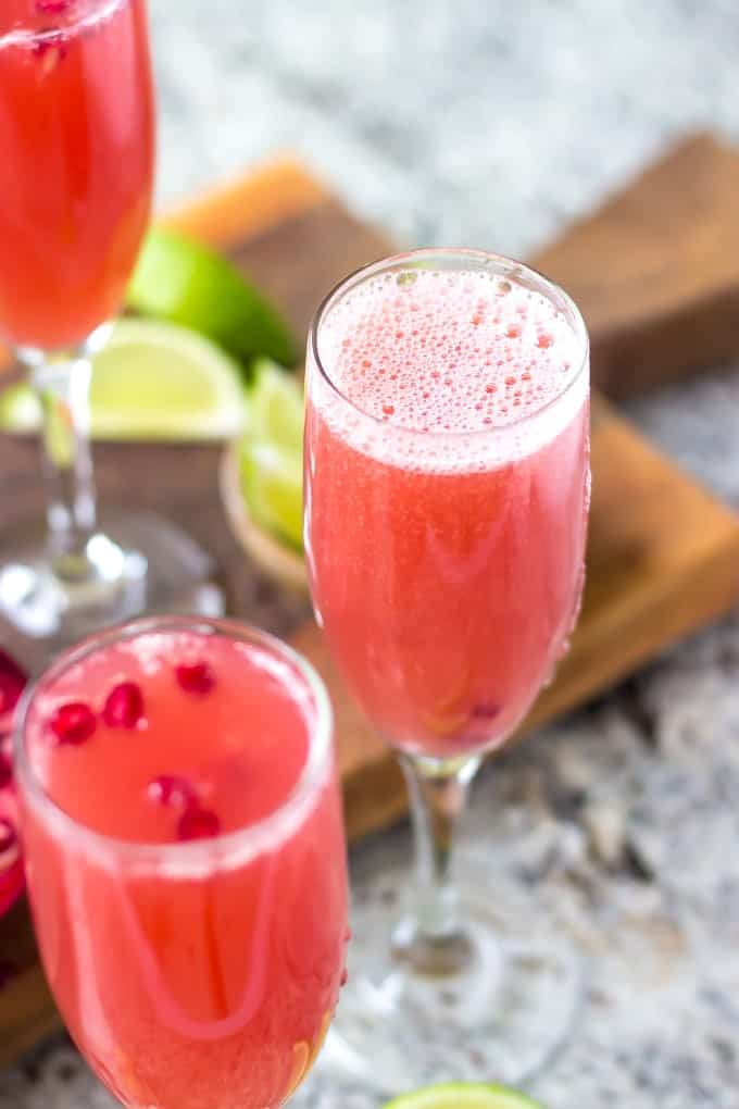Mexican Pomegranate Mimosas - Orange juice, pomegranate juice, lime juice, tequila, and champagne gets combined for one delicious cocktail!