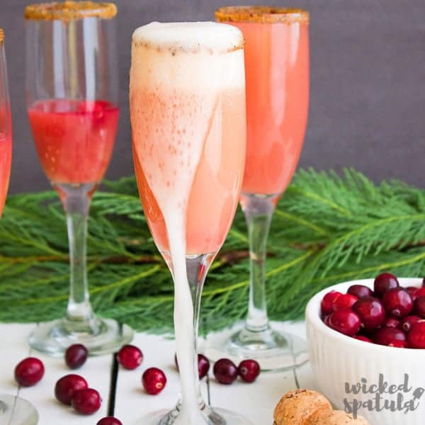 cranberry mimosa overflowing champagne glass