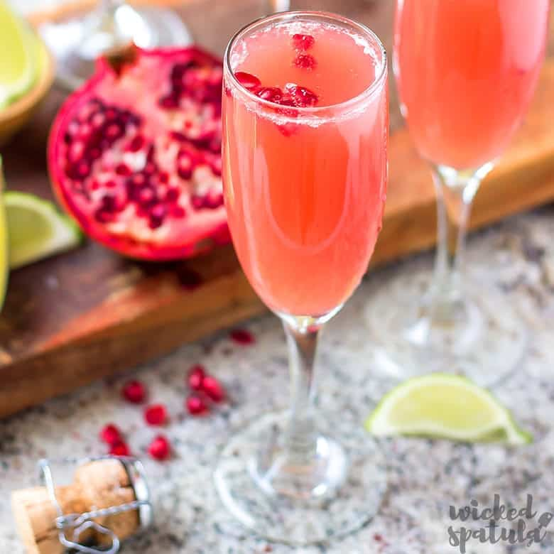 Mexican Pomegranate Mimosas in a champagne glass