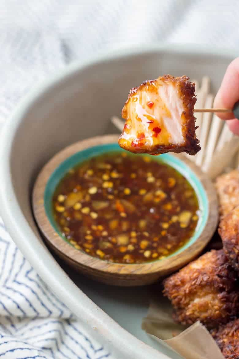 Quick Paleo Coconut Salmon Bites dipped in chili sauce