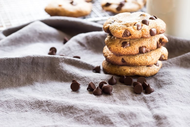 best paleo chocolate chip cookies in a stack on a cloth