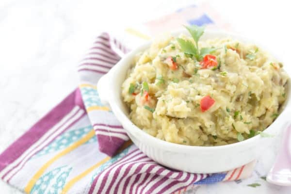Slow Cooker Mexican Mashed Potatoes - This spin on classic mashed potatoes is spiced up with bell peppers, onions, green chiles, and jalapeños!