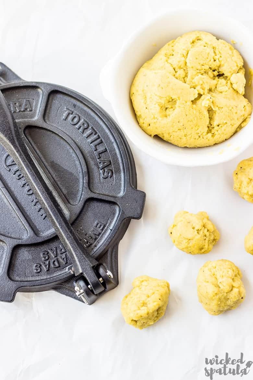 grain-free tortillas in balls with tortilla press