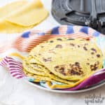 stack of plantain tortillas on dishcloth