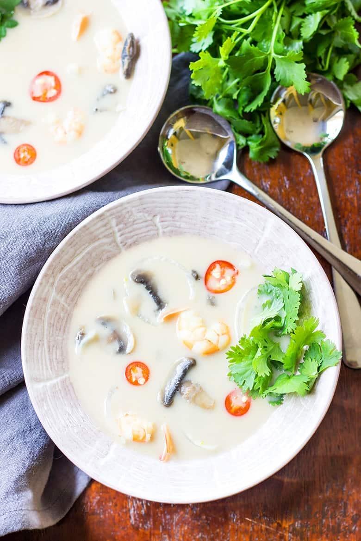 Thai coconut shrimp soup in bowls