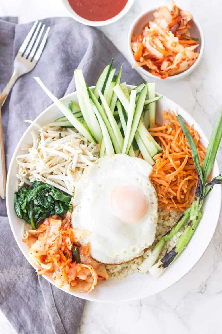 This Korean Paleo Bibimbap is packed full of healthy vegetables, kimchi, and fried eggs!