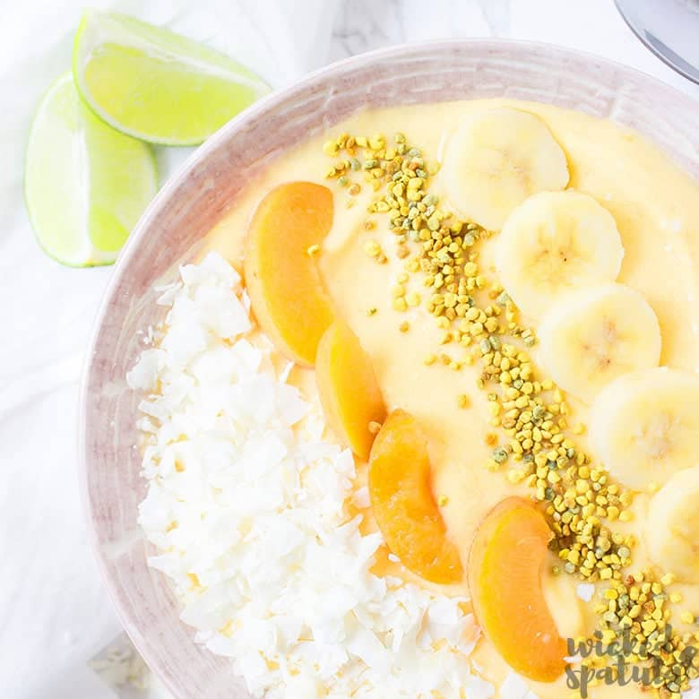 mango smoothie bowl with toppings