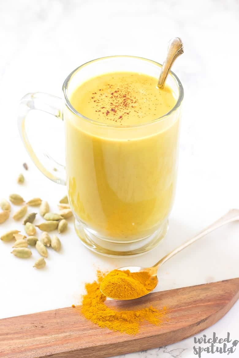 golden turmeric latte in mug with spoon
