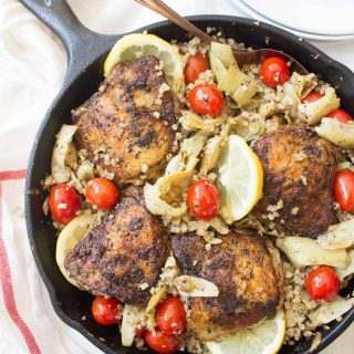 This Greek Lemon Chicken is bursting with flavor from a delicious marinade, cherry tomatoes, artichokes, and a lemon cauliflower rice all made in one pan!