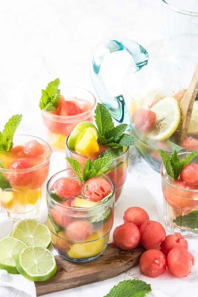 white wine sangria recipe in a clear pitcher