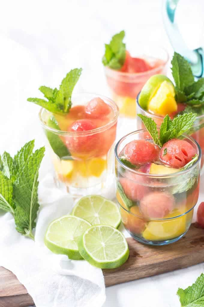 peach sangria in clear glasses with garnish