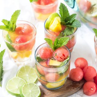This summer sangria is packed full of peaches, mango, limes, lemons, watermelon, wine, and tequila! It's perfectly refreshing!