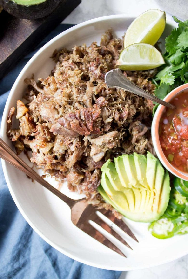 These Slow Cooker Paleo Carnitas are the CRISPIEST Carnitas You'll EVER Have! Just 3 ingredients is all you need! Makes the best tacos, burritos, and more!