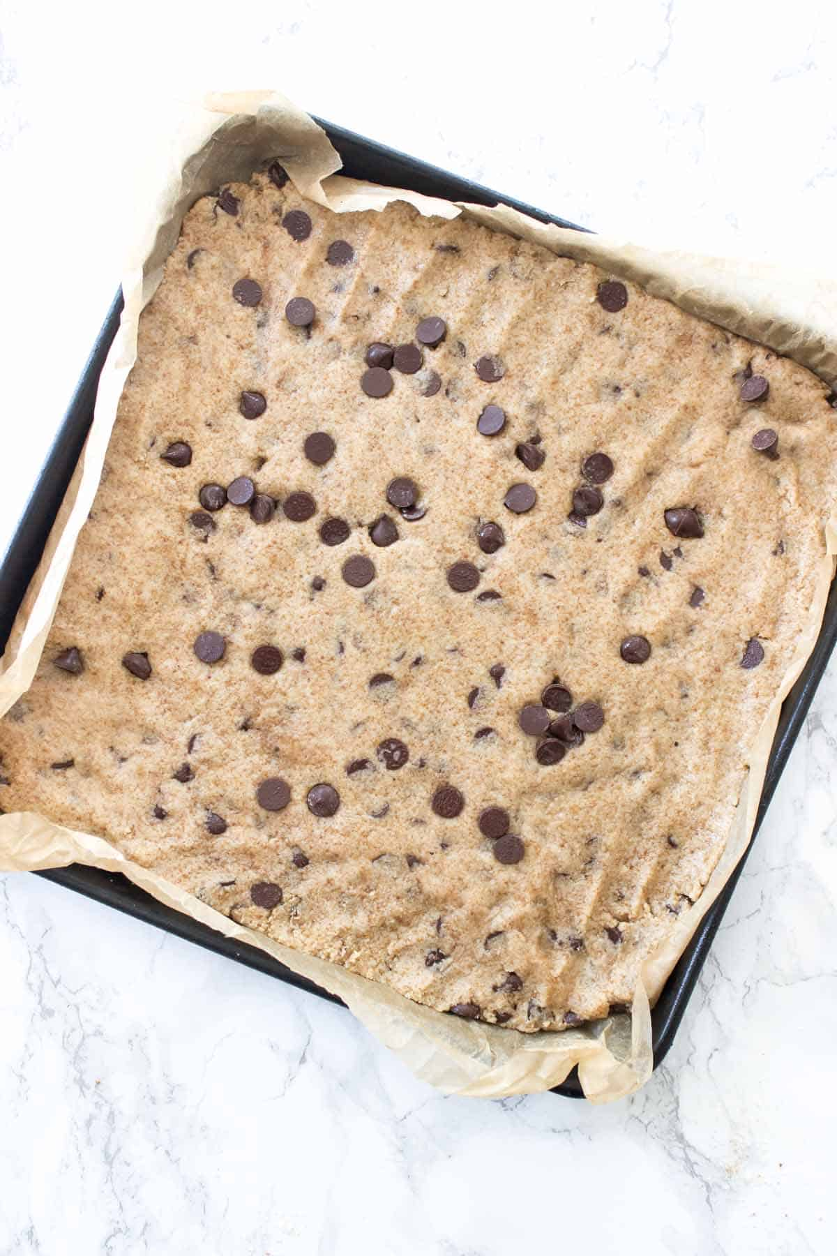 This Paleo Chocolate Chip Cookie Brittle is crunchy just like the outside of a perfectly baked cookie. All you need is one bowl and a few simple ingredients!