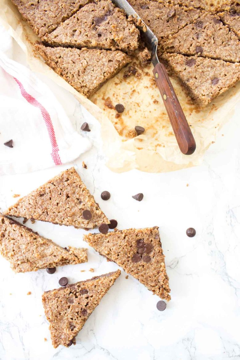 This Paleo Chocolate Chip Cookie Brittle is crunchy just like the outside of a perfectly baked cookie. All you need it one bowl & a few simple ingredients!