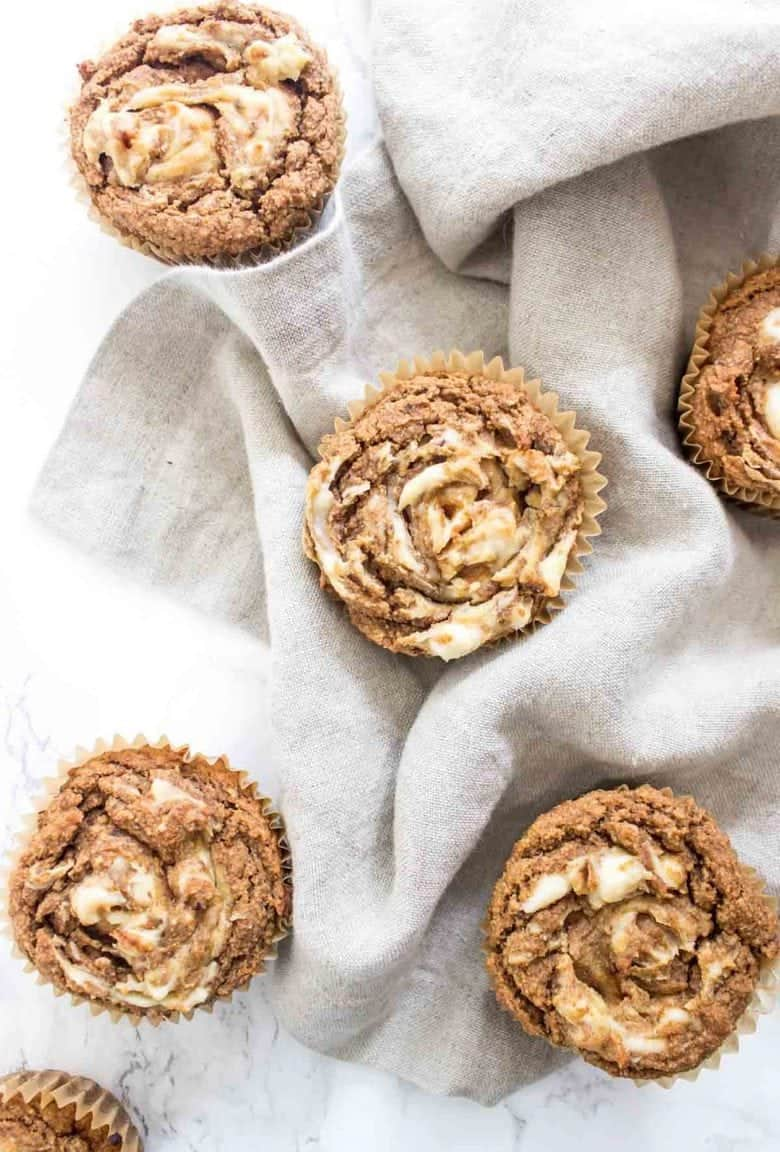 """These Pumpkin """"Cream Cheese"""" Swirl Muffins are paleo, vegan, and 100% delicious! They also freeze well."""