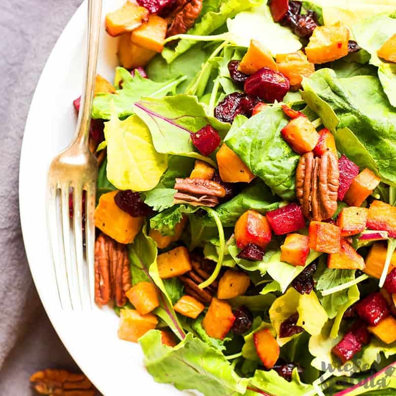 fall harvest salad on a plate with a fork